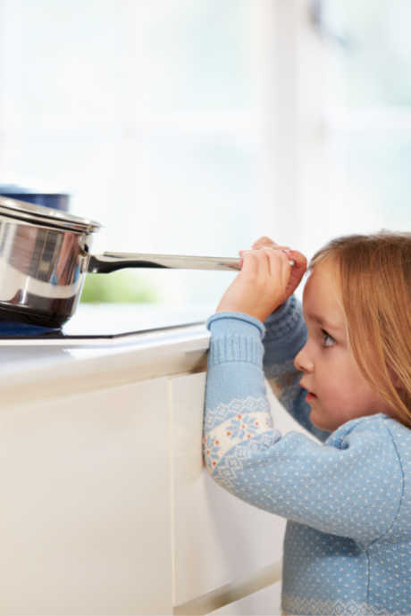 Kitchen Safety Tips: On the stovetop, turn the handles of pots and pans so they don't extend over the edge of the stovetop. Not only will this prevent kids from grabbing at them, you're also less likely to bump into them yourself.