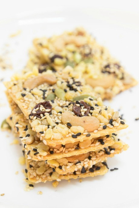 Homemade Crackers: Before you start sprinkling seeds and herbs and seasonings over your dough, brush it with water to be sure they'll stick.