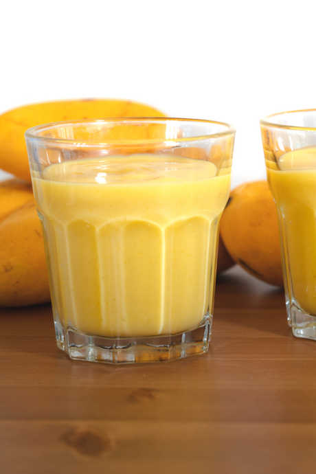 To make Mango Lassi, use Kent or Ataulfo mangoes for their sweet taste and creamy texture. Blend with plain yogurt, milk, ice, and sugar to taste.