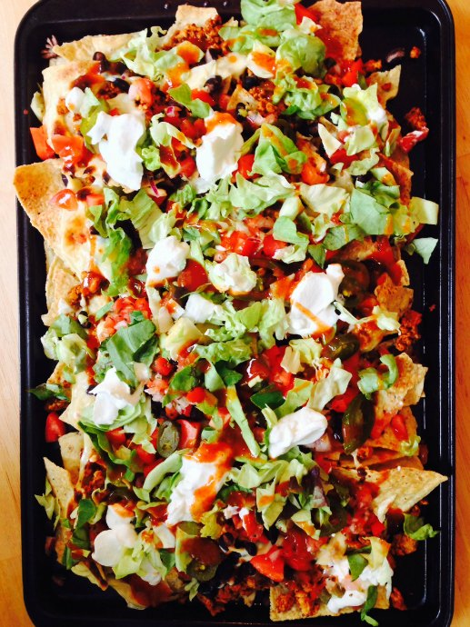 Tips for Homemade Nachos: Baking nachos in the oven ensures all the hot toppings stay hot, the cheese melts, and the chips are crispy.