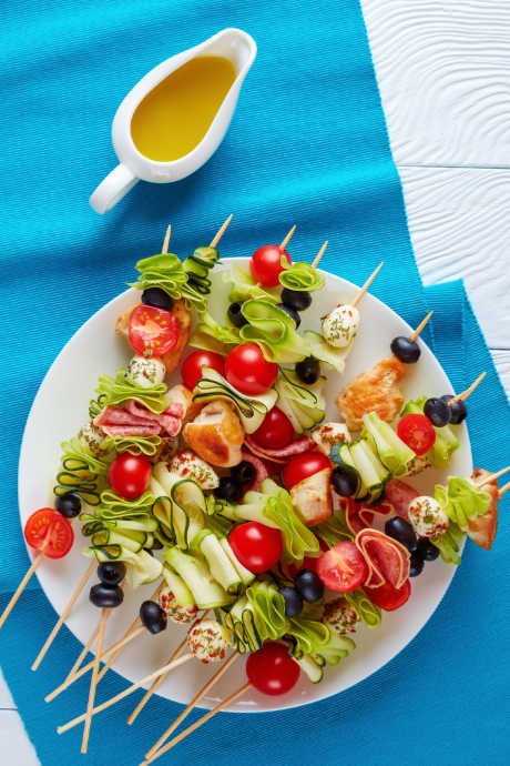 Picnic-Proof Dishes: Skewers are a smart way to combine ingredients without the hassle of serving dishes and utensils. Pass out individual portions to enjoy right from the wooden or bamboo sticks.