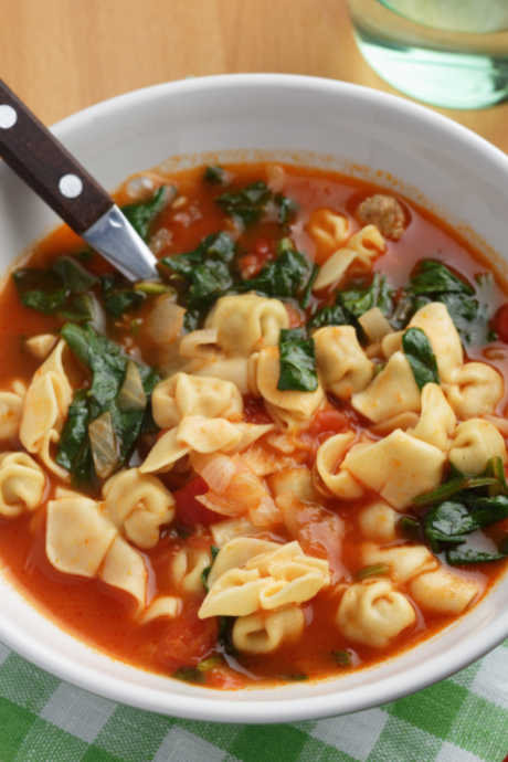 Spinach, Tomato, and Garlic Tortellini Soup: Add tomatoes, garlic, and spinach to simmering broth, and then stir in tortellini for a meal everyone will love.