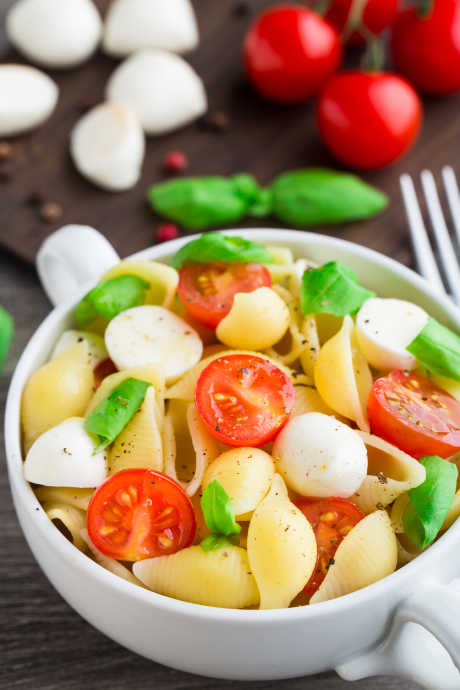 Pasta Salad: Tomatoes, basil, and mozzarella are all excellent add-ins to pasta salad.
