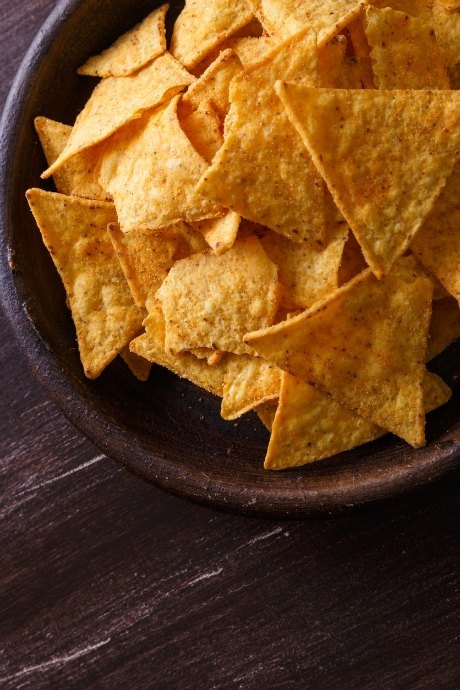 Tips for Homemade Nachos: Use sturdy chips that can hold meat, cheese, beans, guacamole and sour cream, along with any other toppings you choose.